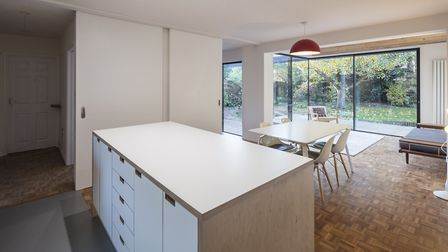 """Sliding doors connect the sitting room to the kichen/diner. """"If you're cooking you can pull that acr"""