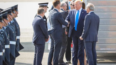 Donald Trump is greeted by Jeremy Hunt at Stansted. Picture: CELIA BARTLETT PHOTOGRAPHY