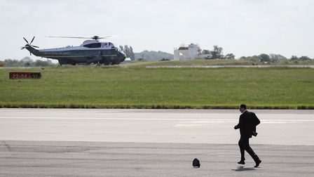 The wind sent a hat flying across the asphalt as the president arrived at Stansted. Picture: CELIA B