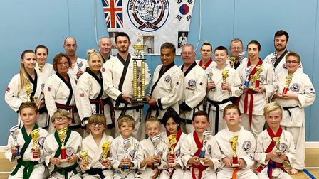 Huntingdon & St Ives Tang Soo Do Club members show off their haul of National Championships trophies