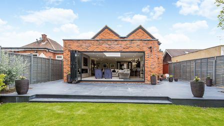 Bi-fold doors open out onto the garden. Picture: Hamptons