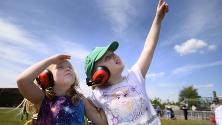 Young visitors gaze up at the air displays at the 2019 Duxford Air Festival at IWM Duxford. Picture: