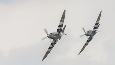 A pair of Spitfires put on a display at the Daks Over Duxford event at IWM Duxford. Picture: Gerry W