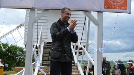 Sam Smith on steps of Great Chishill Windmill after cutting the ribbon ceremony. Picture: Neil Heywo