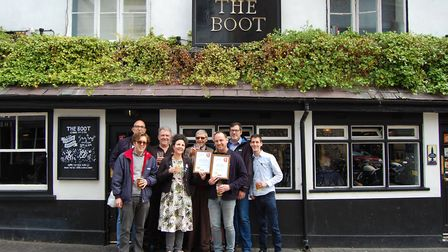 Save St Albans Pubs being presented with the CAMRA award outside The Boot. Picture: CAMRA
