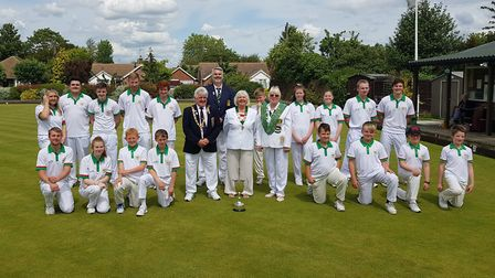 The two Hunts Under 25 teams with English Bowling Federation national president Mick Rayson, Needing