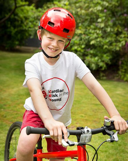 Ollie Higman-Hall is cycling 10 miles for CRY, after his father, Darren, passed away before he was b