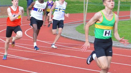 Julian Priest (right) completed a sprint double at the Cambridgeshire County Schools' Championships.