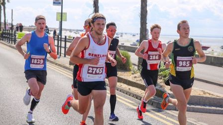 Ty Farrer of Hunts Ac (right) during the Southend Half Marathon. Picture: SUBMITTED