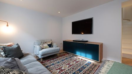 The basement makes an ideal media room for the family of four. Picture: Mark Sims