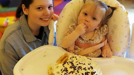 Willow enjoying her first birthday cake alongside sister Gracie. Picture: Emma Howard