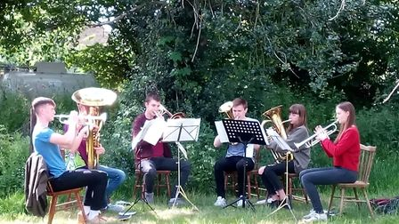 Members of Royston Town Band entertain the hosts and visitors. Picture: Clare Davies and Alix Cooper