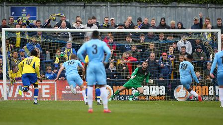 Dean Snedker of St Albans saves a penalty for St Albans City against Torquay United. Picture: DANNY
