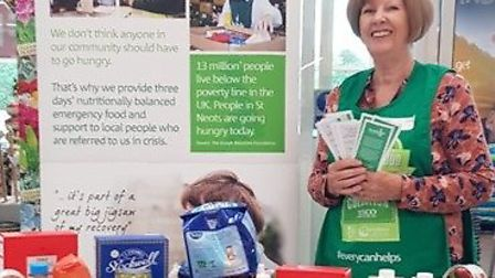 St Neots Foodbank volunteer Pat Evans with some of the food collected at Tesco