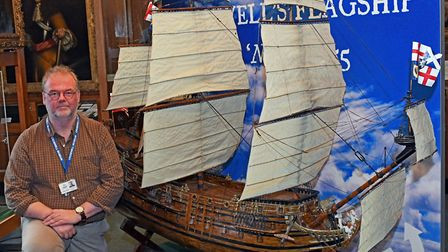 Cromwell Museum curator Stuart Orme with the model of the Naseby