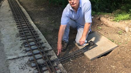 Peter Bradford showing the damage at the miniature railway track in St Neots