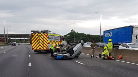 The overturned car on the M25. Picture: BCH Road Policing