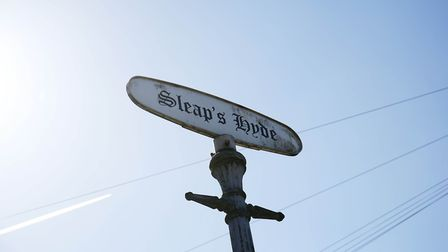 The hamlet's characterful sign. Picture: DANNY LOO