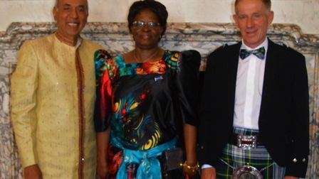 Prakash Sharma, Kasifa Puffet and Graeme Dargie collectively dressed in traditional wear from their