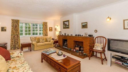 The living room enjoys a bright dual aspect with fantastic views to the front and rear gardens. Pict