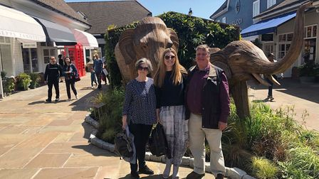Alison Callan. who is orginally from St Albans, with her parents on her trip to the UK to collect th