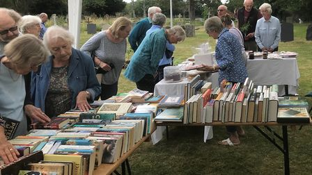 Book and cake stalls at Whaddon fete. Picture: David Grech
