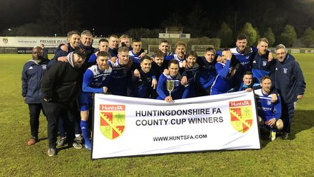 Godmanchester Rovers celebrate their Hunts Senior Cup triumph over St Neots Town last season. Those