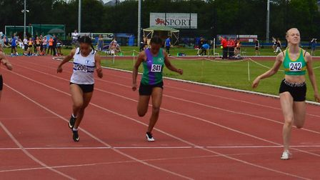 Hunts AC star Lizzy Harrison (green) is pipped to victory in her 100m race. Picture: WAYNE DUBOSE