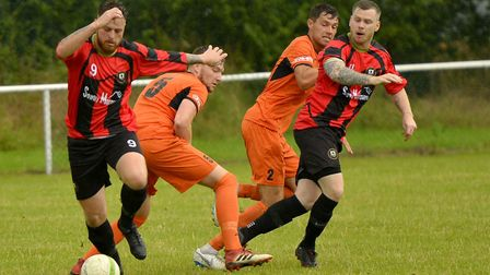 Action from the Hunts Premier Cup fixture involving Huntingdon Town and St Ives Town. Picture: DUNCA