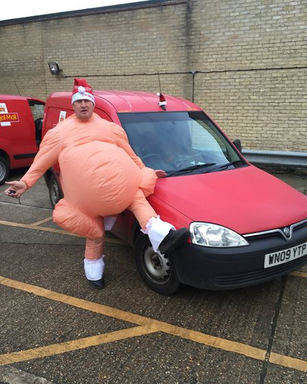 Geoff Martin dresses up on his rounds during the Christmas period