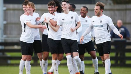 Tom Newman celebrates with team mates after doubling Royston's lead in the match between Royston Tow
