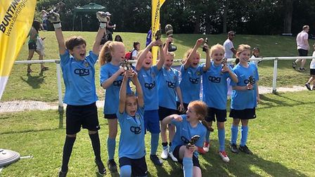 St Albans City Youth's under-nine girls celebrate at the Buntingford festival
