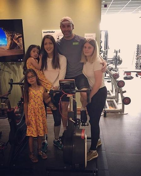 Anthony Powell from Flamstea, pictured with his family, will cycle one million metres for a baby ban