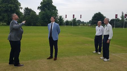 Waresley skipper Steve Warman tosses the coin ahead of the game against the MCC as opposition captai