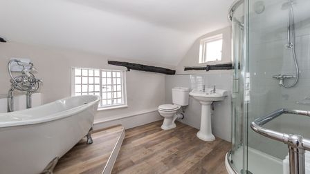 The family bathroom has a roll top bath and separate shower unit. Picture: Ashtons