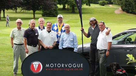 (3rd from right) Wheels for Martin's Friends chairman Peter Furmston with golfers at the charity gol