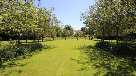 The property sits in mature lanscaped grounds of just over an acre. Picture: John Curtis