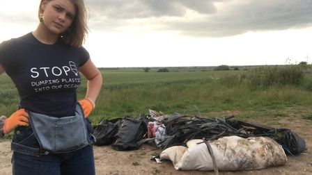 Ellice Wilson with some of the rubbish she managed to collect from the roadside in Ramsey. Picture: