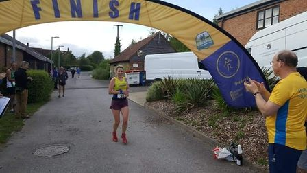 St Albans Striders' Anna Buckingham at the finish of the Ridgeway Relay Race at Ivinghoe.
