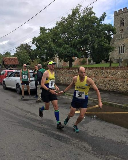 St Albans Striders' Mike Martin and Gary Warren at a transition point at the Ridgeway Relay Race at