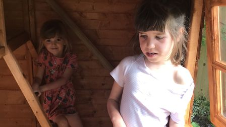 Olivia Kulina, eight, and sister Sophia, five, enjoying their new playhouse. Picture: Andy Kulina