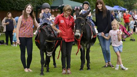 Hannah and daughter Maisy Arnott, 3, Liz from Mikes Donkeys, Lily 2, and mum Emma with daughter Emil