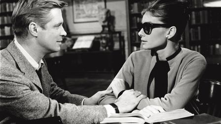 The British actress Audrey Hepburn acting along American actor George Peppard in the film 'Breakfast