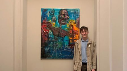 Oli Kellert with his exhibited piece of artwork at the Royal Academy of Arts.