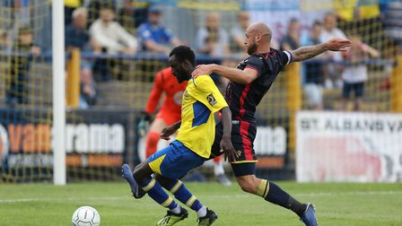 Bobson Bawling of St Albans holds off Scott Cuthbert of Stevenage in the box during St Albans City v