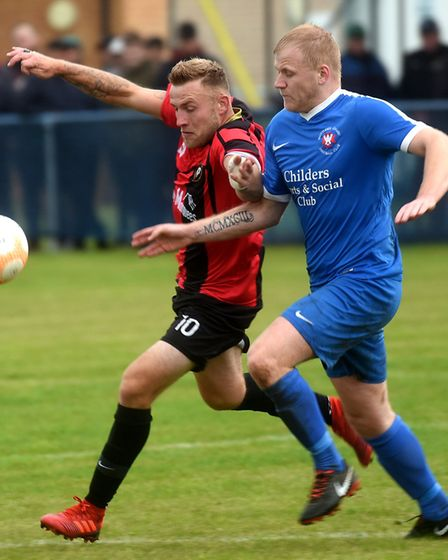 Whittlesey Athletic man Jack Carter battles for the ball against Huntingdon Town. Picture: IAN CARTE