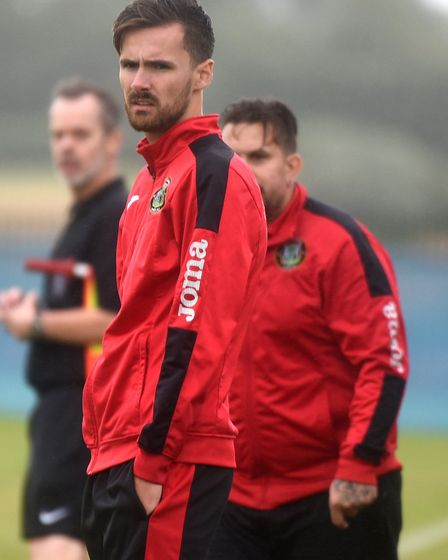 Huntingdon Town coach Alex Cook looks on during the game at Whittlesey Athletic. Picture: IAN CARTER