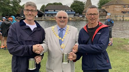 Stuart Williams (left) and Jim Farrell (right) are presented with their trophies by St Neots mayor,