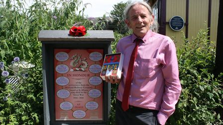 Les O'Leary, of the St Albans Signal Box Trust, holds his grandfather's medals. Picture: Nina Morgan
