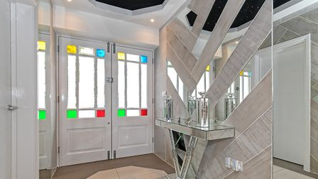 Double doors open into an elegant reception area. Picture: Cassidy & Tate